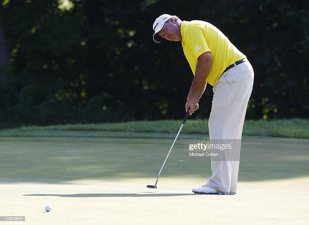 <a gi-track='captionPersonalityLinkClicked' href=/galleries/search?phrase=Boo+Weekley&family=editorial&specificpeople=3486615 ng-click='$event.stopPropagation()'>Boo Weekley</a> strokes a putt during the first round of the John Deere Classic held at TPC Deere Run on July 11, 2013 in Silvis, Illinois.