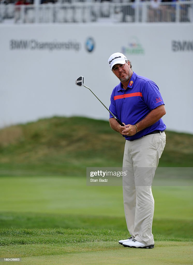 Boo Weekley watches his putt on the 18th green during the first round of the BMW Championship at Conway Farms Golf Club on September 12, 2013 in Lake Forest, Illinois.