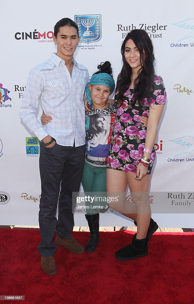 Booboo Stewart (L) and <a gi-track='captionPersonalityLinkClicked' href=/galleries/search?phrase=Fivel+Stewart&family=editorial&specificpeople=5553784 ng-click='$event.stopPropagation()'>Fivel Stewart</a> (R) attend the Children Uniting Nations' Day of The Child Fundraiser held at the Santa Monica Pier on November 18, 2012 in Santa Monica, California.