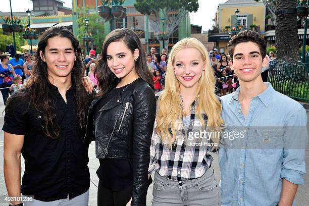 Booboo Stewart Sofia Carson Dove Cameron and Cameron Boyce of Disney's 'Descendants' perform and join fans at Downtown Disney at Disneyland Resort on...