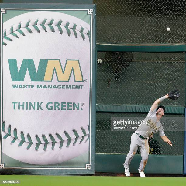 Boog Powell of the Oakland Athletics catches Derek Fisher of the Houston Astros fly ball in the fourth inning at Minute Maid Park on August 19 2017...