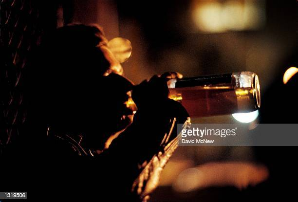 Booger drinks beer in the dark after he and some friends begged enough money to buy a case of 40ounce beers December 14 2000 in Hollywood CA