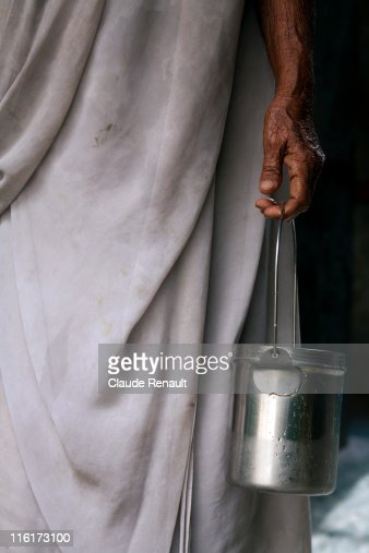 Booghamathi coming out to fetch water . Vrindavan : Stock Photo