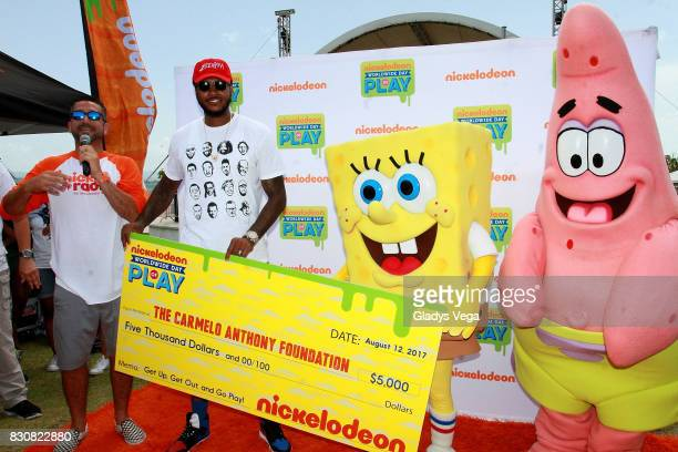Boogie of Nick Radio and Carmelo Anthony present the donation of Carmelo Anthony Foundation with the Nickelodeon Characters as part of the Worldwide...
