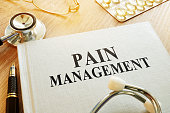 Book about Pain management. Chronic care management concept.