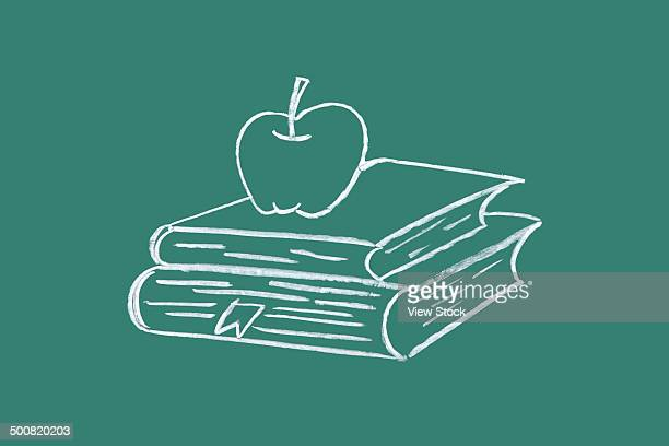 Book and apple drawn on blackboard