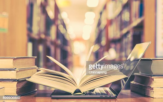 Book and computer technology in library : Stock Photo