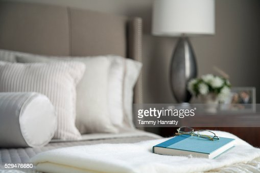 Book and glasses on a shawl : Stock Photo
