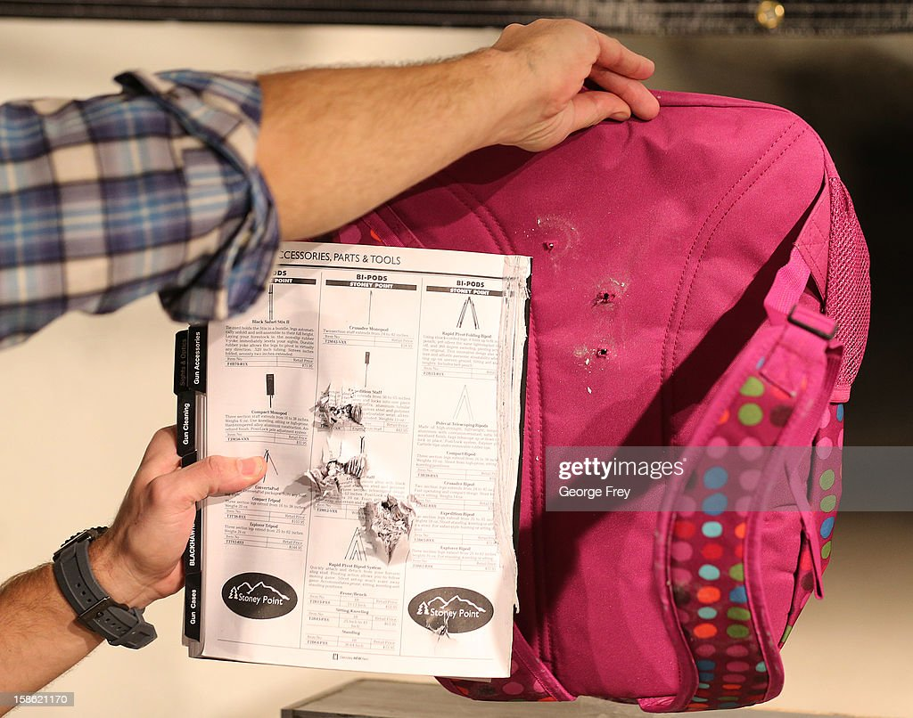 A book and the back of a child's backpack are displayed with the effects of bullets that were shot through it without Amendment II's Rynohide CNT Shield on December 21, 2012 in Salt Lake City, Utah. Their orders for the bulletproof shield have gone up dramatically since the school shooting in Connecticut last week.
