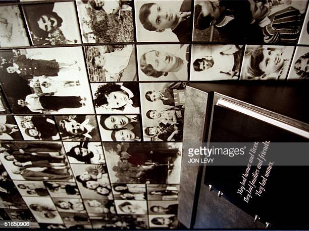 A book containing the names of holocaust victims sits in front of a wall montage of their photographs 09 September at the Museum of Jewish Heritagea...