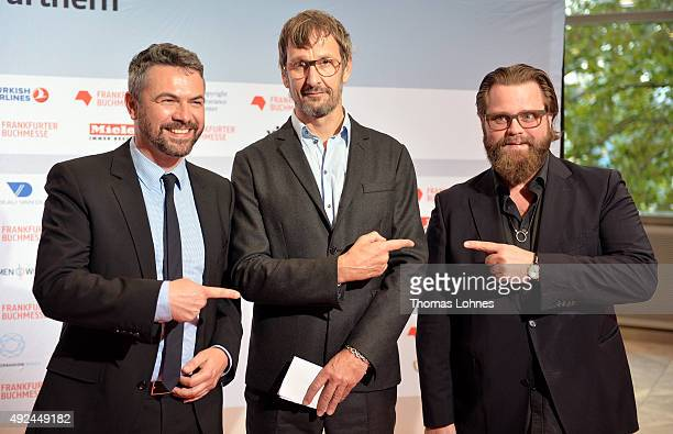 Book fair Vice President Holger Volland painter Daniel Richter and actor Antoine Monot pose at the red carpet before the opening ceremony of the 2015...