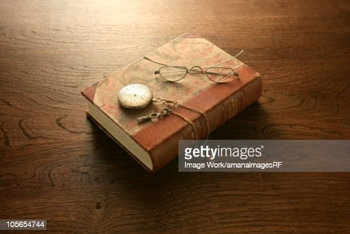 Book, glasses and pocket watch : Stock Photo