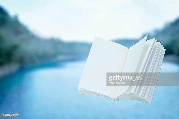Book is floating in the air