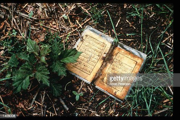 A book lies near a mass gravesite where Serb forces slaughtered Muslim men May 14 1996 in Srebrenica Bosnia and Herzegovina Slobodan Milosevic...