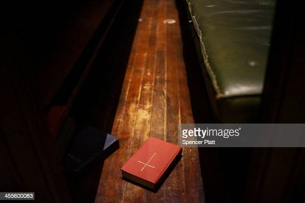 Book of Common Prayer sits in a pew at a Times Square church where some area homeless take refuge from the cold on December 12 2013 in New York City...