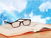 Close-up Black reading glasses and book