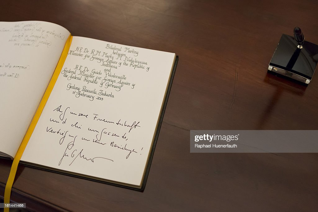 A book, signed by German Foreign Minister Guido Westerwelle, rests on a table as he and his Indonesian counterpart Marty Natalegawa meet for talks, at the foreign office on February 10, 2013 in Jakarta, Indonesia. Westerwelle is with a economic delegation on a southeast asia tour, Jakarta is the end of his tour.