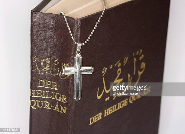 Book spine and cover of a Koran with cross on January 13 2015 in Bonn Germany