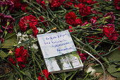 A book with a poetic goodbye message to Ethem Sarisülük with a lit cigarette of his favorite brand is left as an offer on the flowers laid on the...