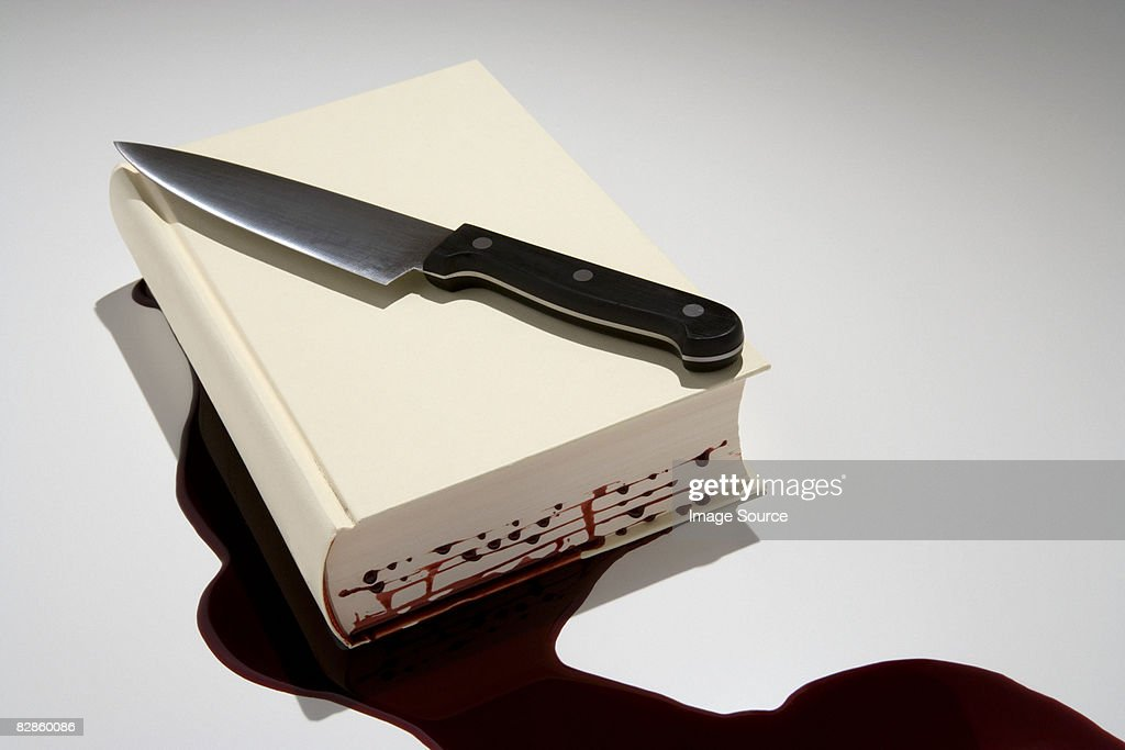 A book with blood dripping out of it