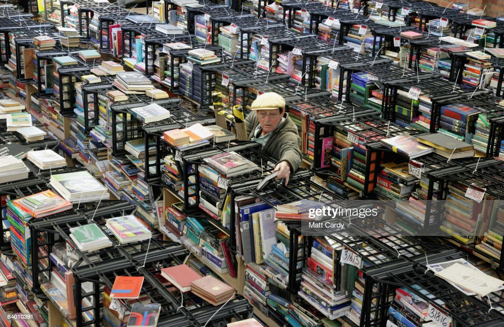 Bookbarn International employee Ken Buckland looks for a second hand book that has been ordered over the Internet in their warehouse on December 12, 2008 near Hallatrow in Somerset, England. Selling most of their books online via websites such as Amazon.com, Bookbarn International is the UK's largest second hand book warehouse with over 5 million titles stored in two giant barns in a field in Somerset. Helped in part by the credit crunch, sales of second hand books have risen sharply recently with the weak British pound only helping the Bookbarn to sell more books internationally.