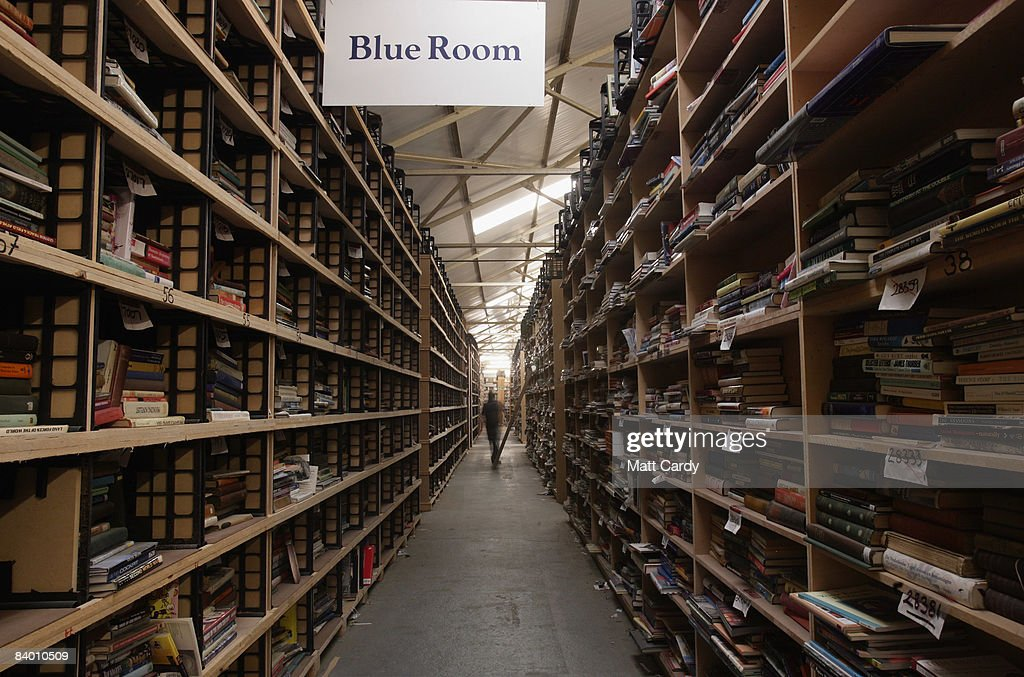 A Bookbarn International employee looks for a second hand book that has been ordered over the Internet in their warehouse on December 12, 2008 near Hallatrow in Somerset, England. Selling most of their books online via websites such as Amazon.com, Bookbarn International is the UK's largest second hand book warehouse with over 5 million titles stored in two giant barns in a field in Somerset. Helped in part by the credit crunch, sales of second hand books have risen sharply recently with the weak British pound only helping the Bookbarn to sell more books internationally.
