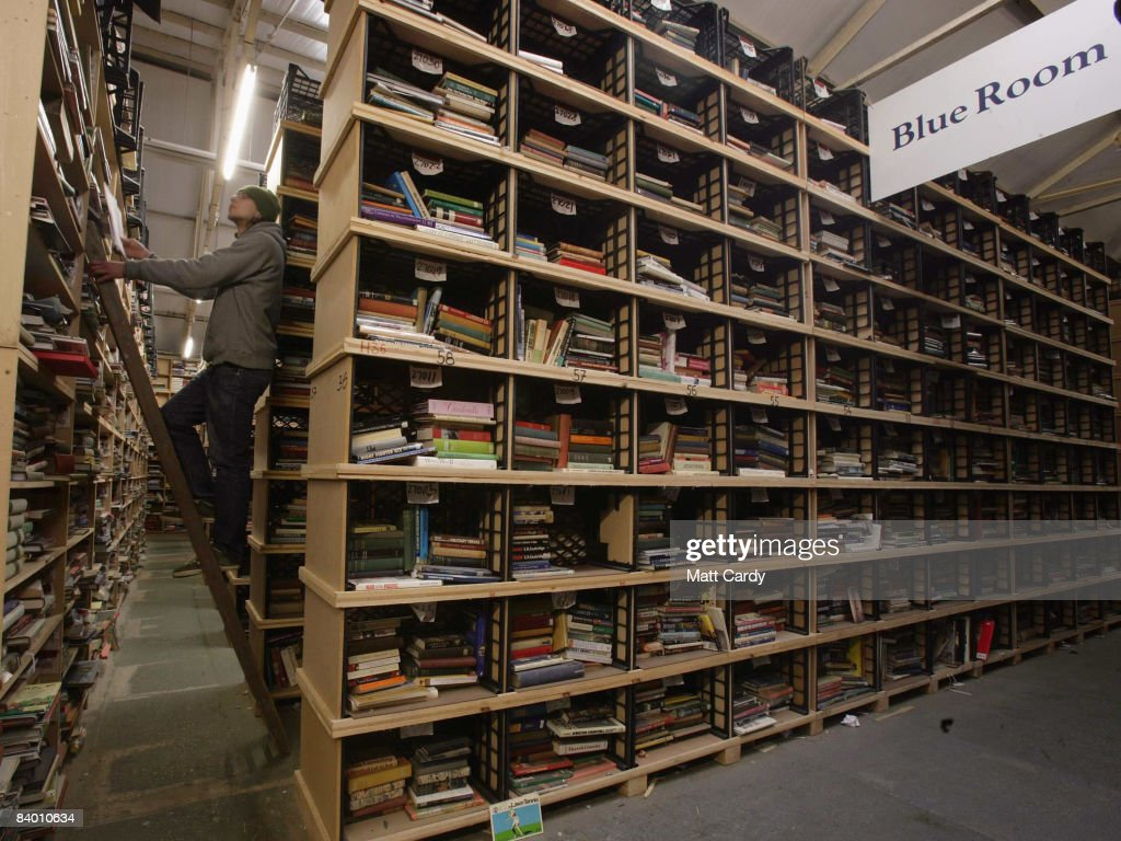Bookbarn International employee Peter Sajdak looks for a second hand book that has been ordered over the Internet in their warehouse on December 12, 2008 near Hallatrow in Somerset, England. Selling most of their books online via websites such as Amazon.com, Bookbarn International is the UK's largest second hand book warehouse with over 5 million titles stored in two giant barns in a field in Somerset. Helped in part by the credit crunch, sales of second hand books have risen sharply recently with the weak British pound only helping the Bookbarn to sell more books internationally.