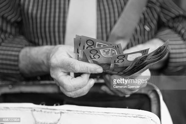 A bookie counts his money on Melbourne Cup Day at Flemington Racecourse on November 4 2014 in Melbourne Australia