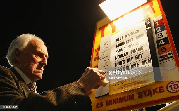 Bookie Douglas Tyler takes bets during the farewell gala evening at Walthamstow Greyhound Stadium on August 16 2008 in London England The famous...