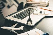 Booking paris trip online on computer