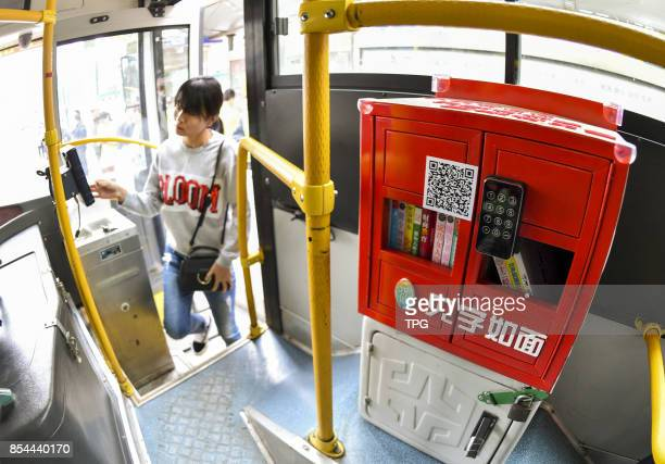 A booklending machine is installed on a bus in Urumqi City capital of northwest Chinas Xinjiang Uygur Autonomous Region Sept 13 2017 After...