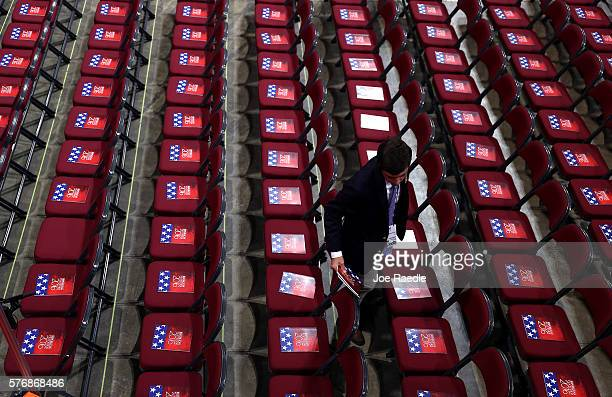Booklets are placed on chairs as the Quicken Loans Arena is prepared for the arrival of delegates on day one of the Republican National Convention on...