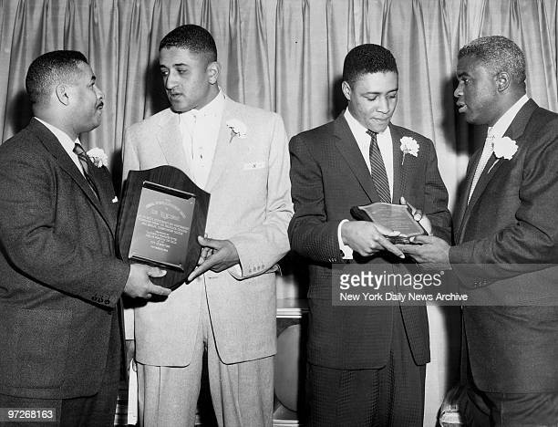 Booklyn Dodgers pitcher Don Newcombe second from left and New York Yankees catcheroutfielder Elstone Howard second from right receive Achievement...