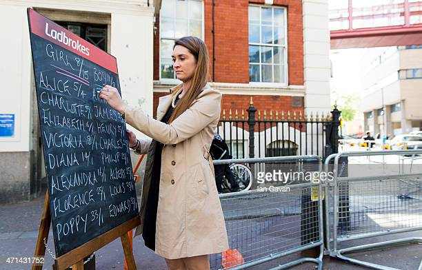 A bookmaker displaying the odds on Royal baby names outside the Lindo Wing at St Mary's Hospital on April 28 2015 in London England Catherine Duchess...