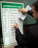 A bookmaker writes up the odds on replacement managers for the England international football team at Football Association headquarters in Soho...