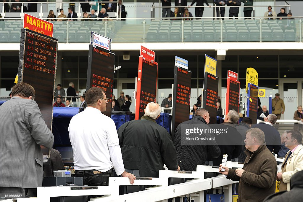 Bookmakers at Newmarket racecourse on October 24, 2012 in Newmarket, England.
