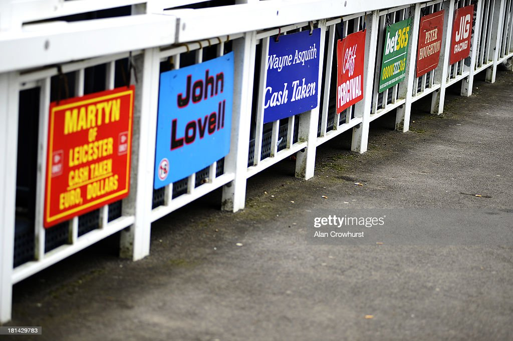 Bookmakers boards below their stands at Newbury racecourse on September 21, 2013 in Newbury, England.
