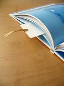 An open book with bookmark.