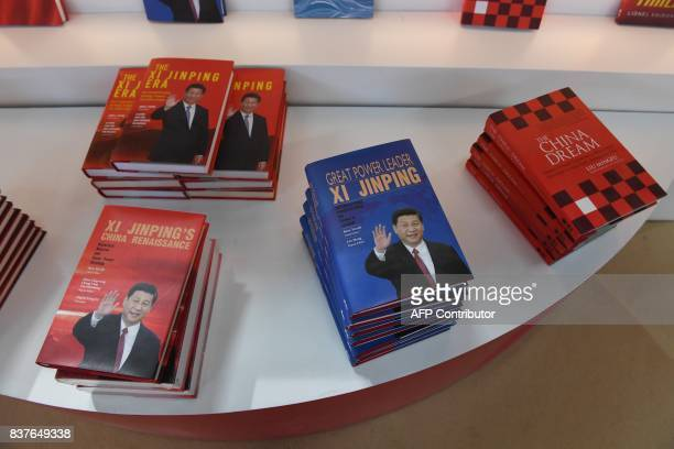 Books about China's President Xi Jinping are displayed at the Beijing International Book Fair in Beijing on August 23 2017 The book fair runs from...