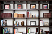 Books and picture frames in shelves