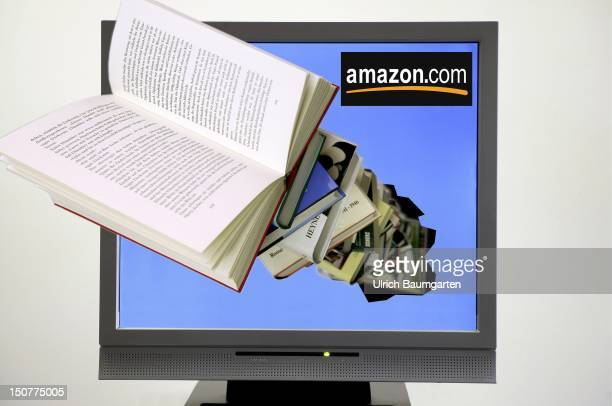 Books appearing out of a computer screen with the logo of amazon