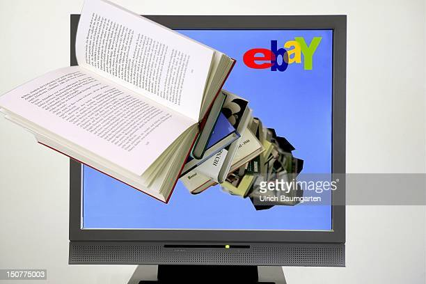 Books appearing out of a computer screen with the logo of ebay