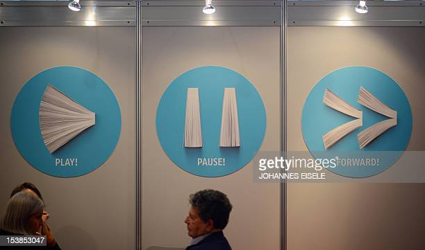 Books are shaped like the icons for play pause and forward at the Frankfurt Book Fair on October 10 2012 in Frankfurt am Main western Germany More...