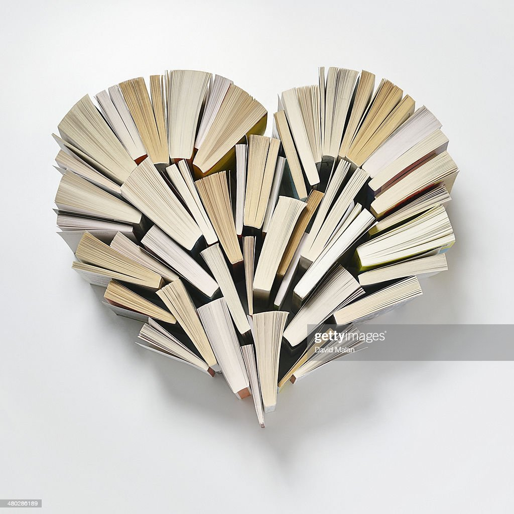 Books arranged in a heart shape