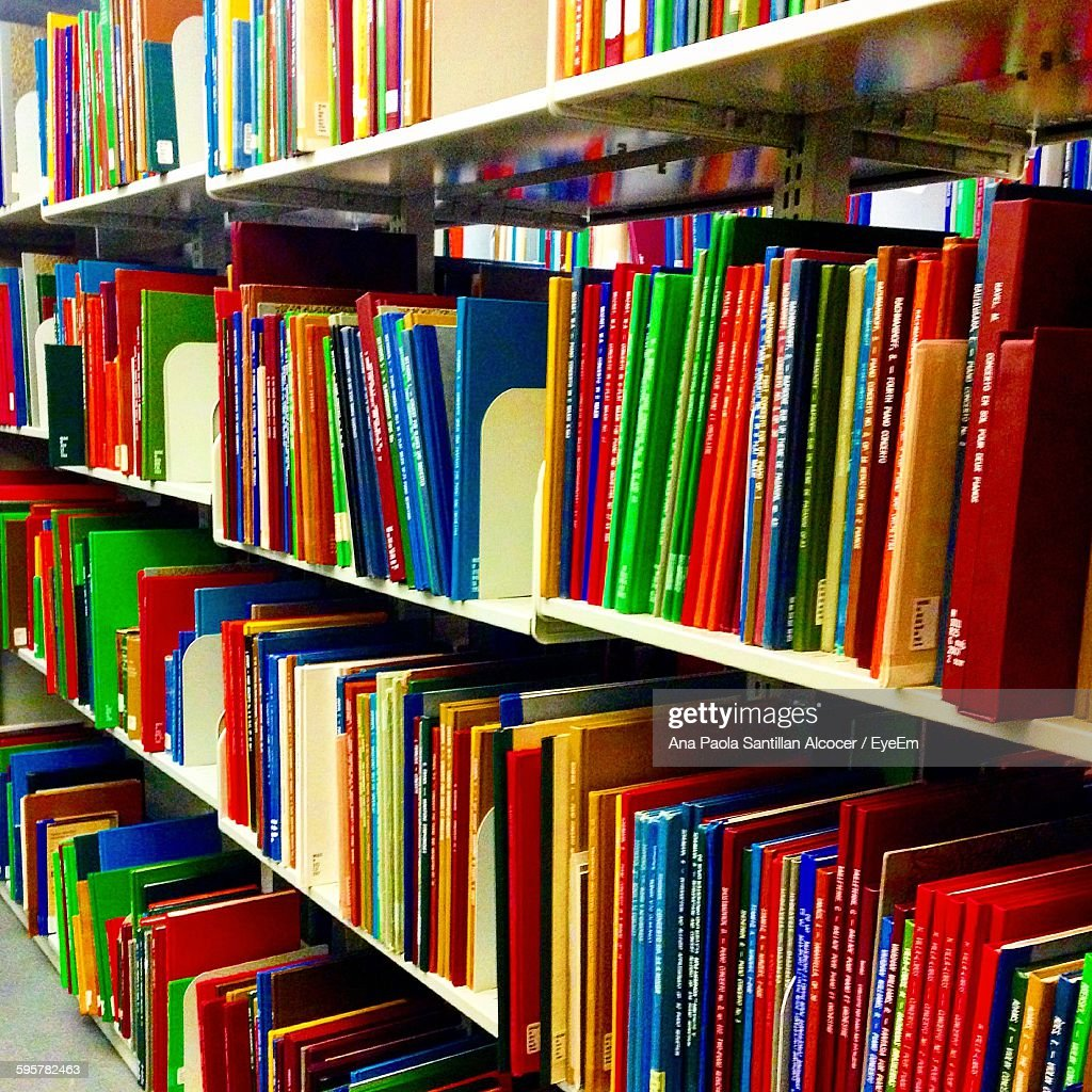 Books Shelves books arranged on shelves at library stock photo | getty images