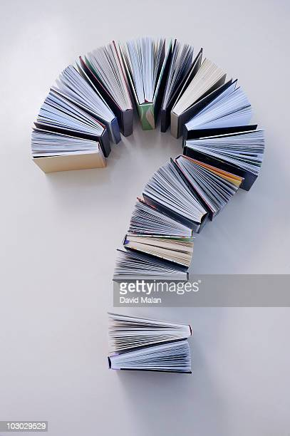 books arranged to form a question mark
