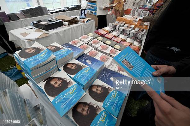Books by Indian spitual leader Sri Sri Ravi Shankar are for sale at a stand at the World Culture Festival at Berlin's Olympiastadion July 2 2011...