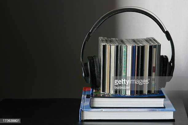 Books, cds and headphones arrangement
