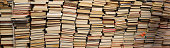 Heap of lots of books on sale in the used bookshelf