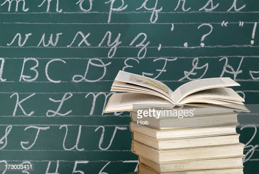 Books in front of a Blackboard